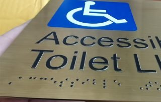 braille signs restroom