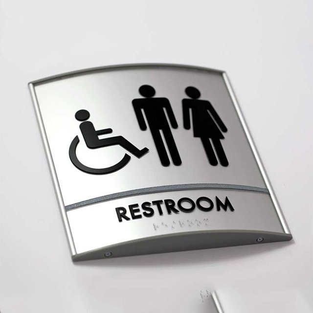 curved restroom braille signs